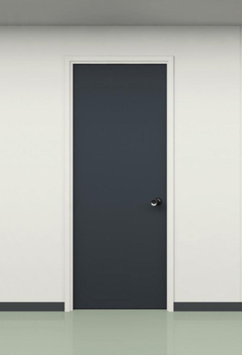 Two black and one red door in office corridor